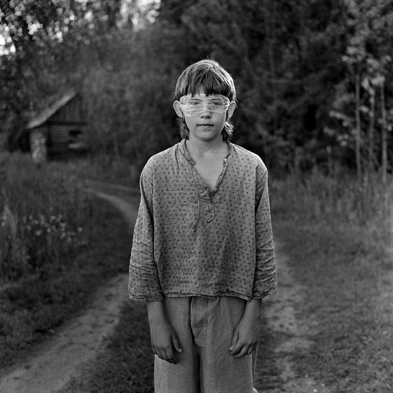Documentary children photography on the street - creative portraits of boys and girls taken on black-and-white film and vintage medium format Yashica Mat-124G and Bronica SQ-Ai cameras by Belarusian photographer Alexander Kladov