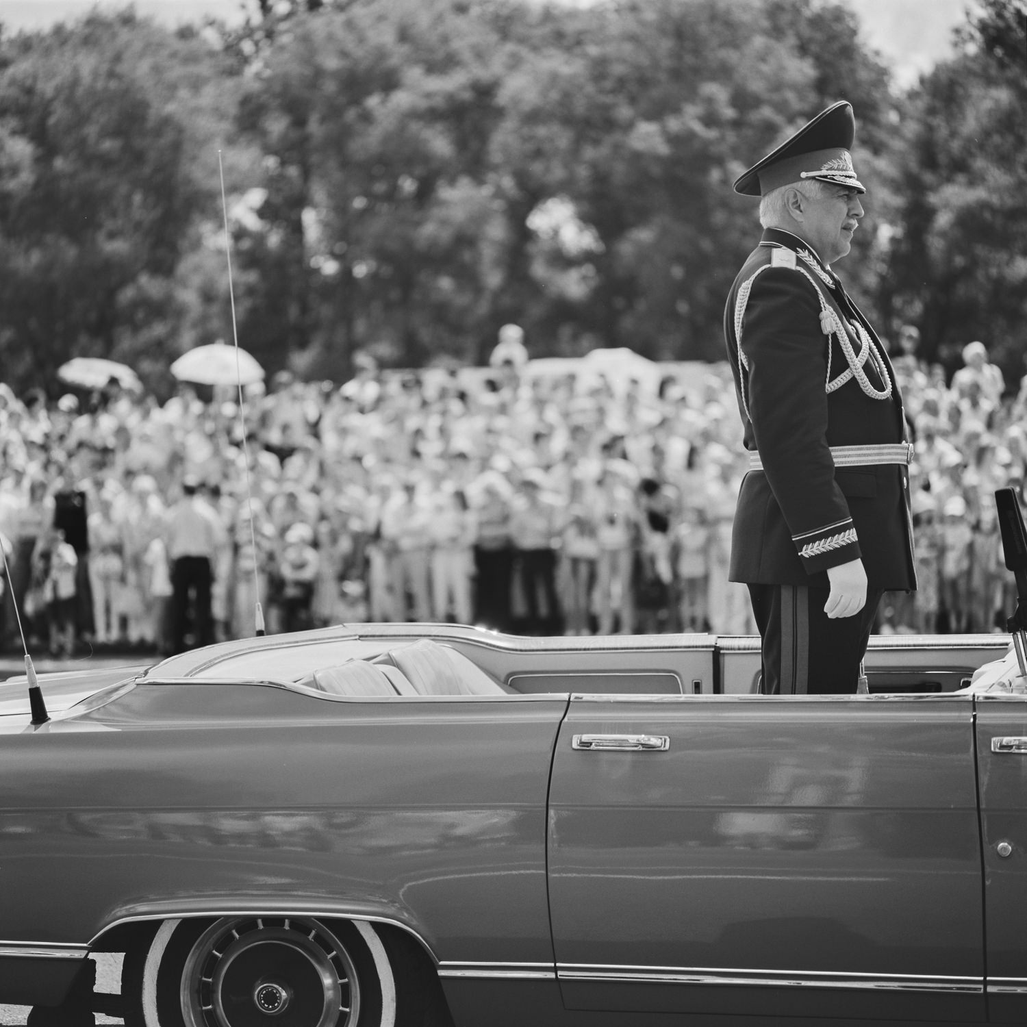 General of the Belarusian army in the car welcomes soldiers and participants of the victory procession, black-and-white film street photo