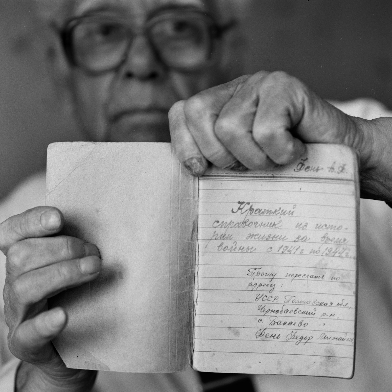 Old veteran showing personal 1941-1945 army notebook in his hands