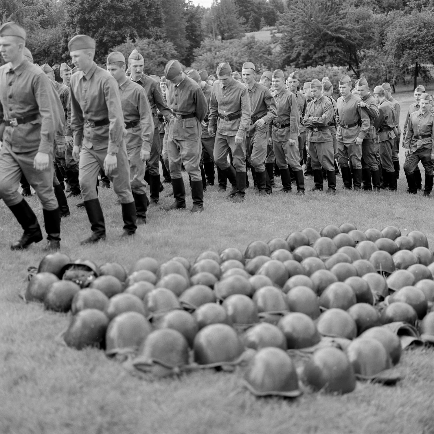 Company of soldiers preparing for the military parade, helmets lie on the lawn on Indepedance Day celebration in Minsk