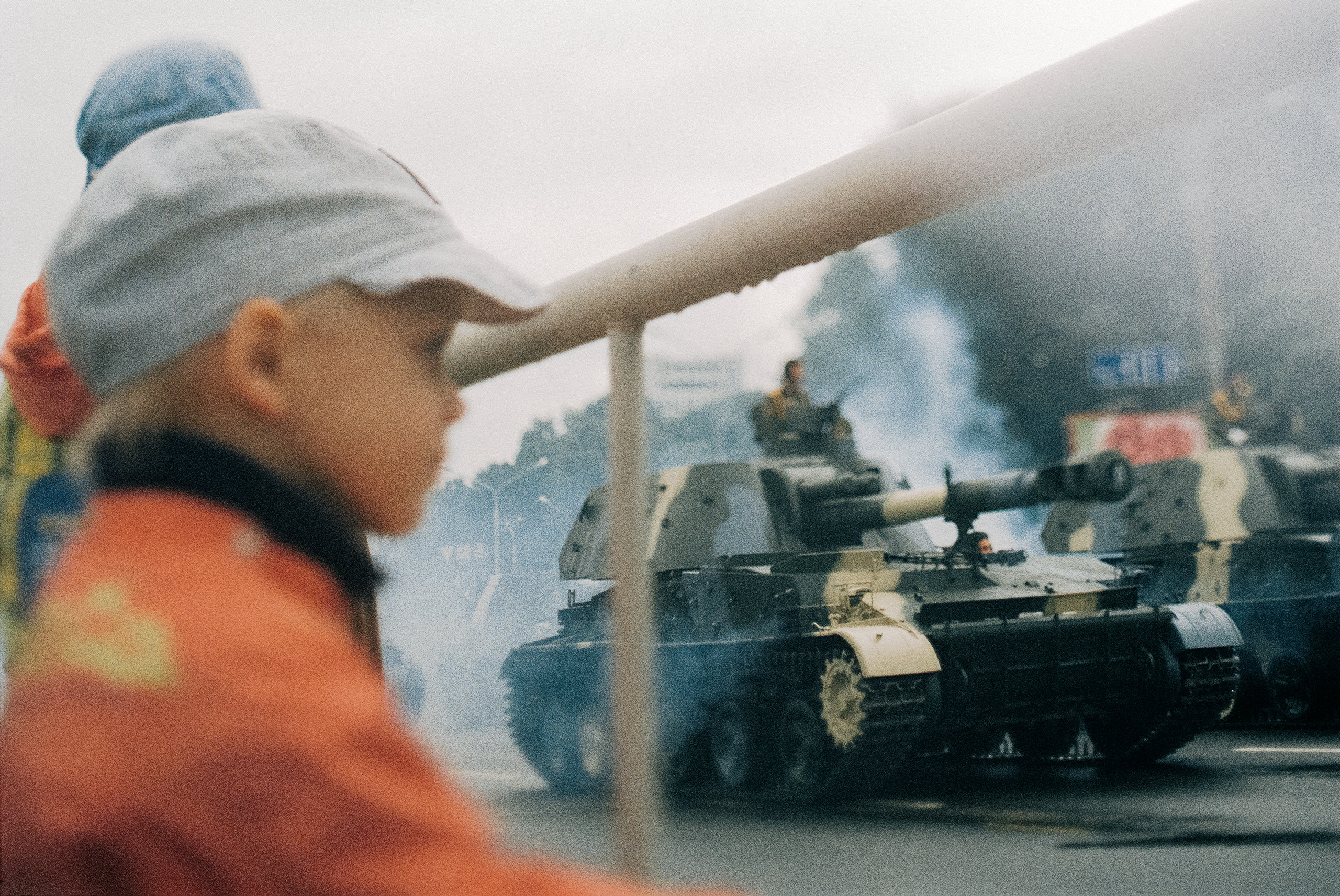 Young children watch the Victory Parade in Minsk, a photo from the documentary series «Military Habits» about veterans of the Great Patriotic War