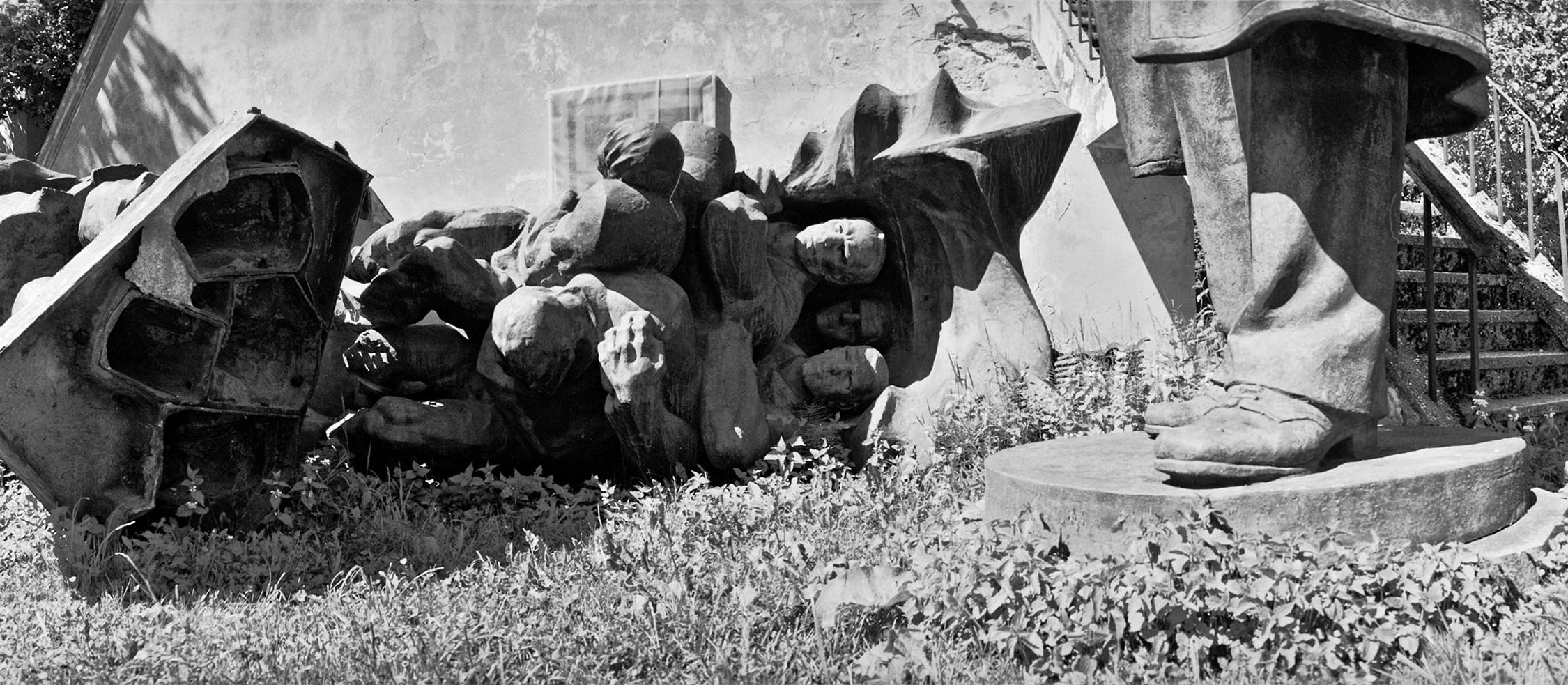 Broken World War Two monuments of USSR army soldiers in the park on the ground